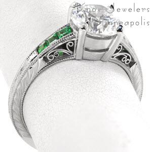 Filigree engagement rings in Milwaukee are a beautiful choice for anyone who enjoys the timeless appeal of vintage techniques. This ring features emerald side stones, hand engraving, and filigree curls.