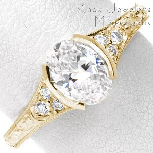 Antique engagement ring in Rochester with oval center stone and scroll engraving.