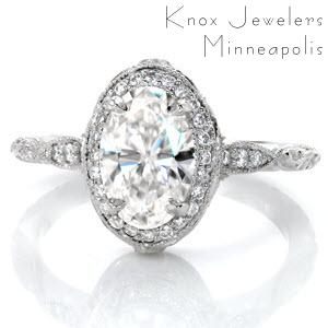 Exquisite halo engagement ring in Omaha features an oval center diamond. The intricate band features hand carved relief engraving, milgrain, and micro pave diamonds.