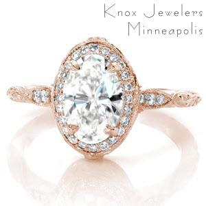 Antique inspired custom engagement ring in Montreal with a unique diamond halo surrounded a oval center diamond.