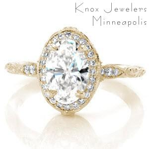 Antique inspired custom engagement ring in McAllen with a unique diamond halo surrounded a oval center diamond.