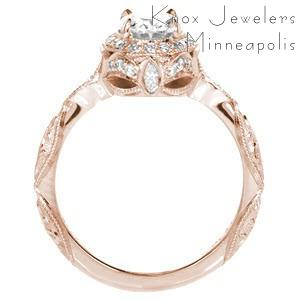 Rose gold custom engagement ring in Indianapolis with a unique diamond halo surrounded a oval center diamond.