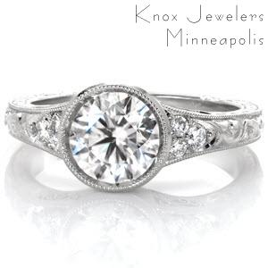 Antique inspired custom engagement ring in Colorado Springs with a round brilliant center diamond held in a setting with unique filigree and hand engraving.