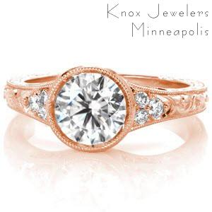 Rose gold custom engagement ring in Sioux Falls with a round brilliant center diamond held in a setting with unique filigree and hand engraving.