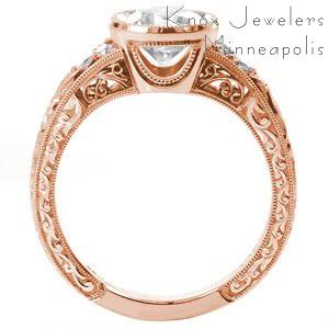 Rose gold custom engagement ring in Louisville with a round brilliant center diamond held in a setting with unique filigree and hand engraving.