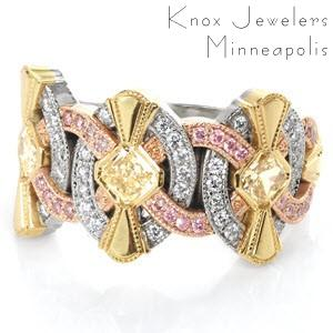 An intricate Art Deco inspired band, Tiara is a stunning collection of gold hues. Diamonds presented are radiant cut yellows with full bezel, surrounded by yellow gold fans. Round cut bead set pink diamonds in rose gold arches, and round cut diamonds within the oval shapes. The split shank band tapers for comfort.