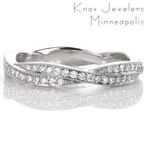 Milwaukee unique wedding bands with infinity twist pattern. This woven wedding band features micro pave diamond bands twisted together for a stunning look.