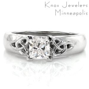 Let your heritage shine with this pristine example of Celtic design. A 0.70 carat princess cut center diamond is distinctively set within chevron prongs. Traditional Celtic knots with openwork frame flank the center diamond. The 14k white gold band has a wider look with rounded profile for a comfortable fit.