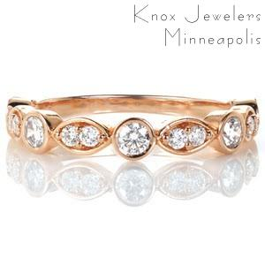 Knoxville rose gold custom wedding ring with a unique band featuring alternating bezel set round diamonds and marquise shaped bead set diamonds.