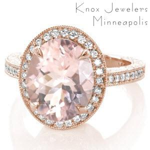 Antique inspired custom rose gold engagement ring in Memphis with an oval morganite center stone surrounded by a diamond halo and held in a hand engraved band.