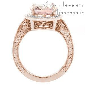 Antique inspired custom rose gold engagement ring in Milwaukee with an oval morganite center stone surrounded by a diamond halo and held in a hand engraved band.