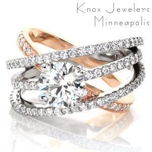 A signature look and statement piece, Design 3296 is a multiple band setting with a 1.50 carat round brilliant diamond. One bead set diamond band of 14k rose gold provides a subtle softness to the modern feel of the trio of 14k white gold diamond bands. The bands are joined at the bottom for a comfortable fit.
