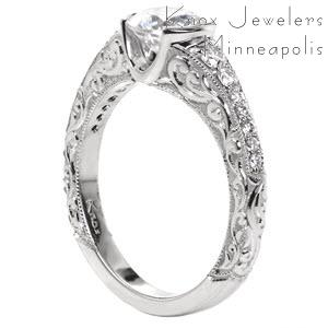 Tucson antique inspired engagement ring with a round diamond center and unique scroll relief engraving.