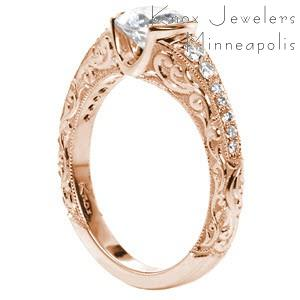 Tucson rose gold engagement ring with a round diamond center and unique scroll relief engraving.