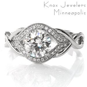 Featuring a 1.00 carat round brilliant cut center diamond, this elegant design has a unique, woven band. The loops of the ring form infinity signs to symbolize your endless love for each other. Dazzling side diamonds surround the center in a pulled halo.