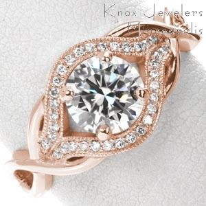 Rose gold engagement ring in Colorado Springs with round brilliant center stone, micro pave diamonds and woven bands.
