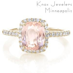 Henderson custom halo engagement ring with a micro pave rose gold diamond band with a unique cushion cut morganite center stone.