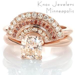 Unique contour wedding band featuring champagne diamonds and red sapphires in Milwaukee. This stunning design is perfect to add some flare to any engagement ring!