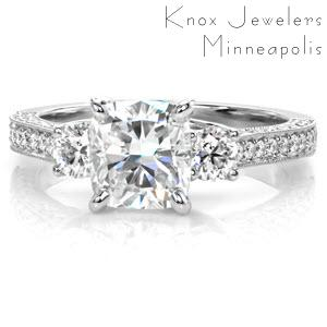 Atlanta three stone engagement ring with cushion cut center stone and round side stones.