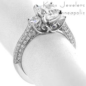 Unique three stone engagement rings in Indianapolis with filigree and a three sided micro pave band. This dazzling ring is set with an array of brilliant diamonds. The sides of the ring feature vintage filigree details on the sides of the center stone setting.