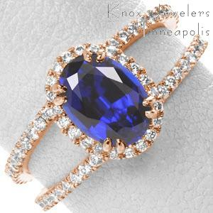 Rose gold engagement ring in Las Vegas with blue sapphire center stone, diamond band and split-shank band.