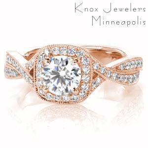 Custom engagement ring in Dayton with a cushion cut center stone surrounded by a bead set diamond halo and twisting band.