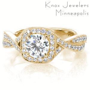 Custom engagement ring in Phoenix with a cushion cut center stone surrounded by a bead set diamond halo and twisting band.