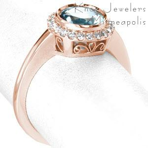 Portland filigree engagement ring with a full bezel aquamarine center gemstone and petite diamond halo.