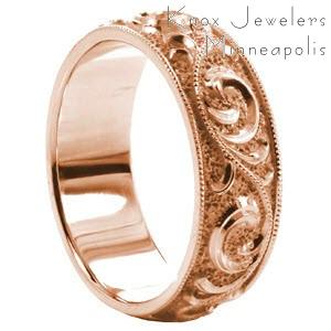 Wide band wedding ring with scroll filigree and milgrain border in rose gold.