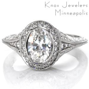 Custom antique inspired engagement ring with an oval cut diamond center surrounded by a diamond halo and a knife edge engraved band in Fargo.