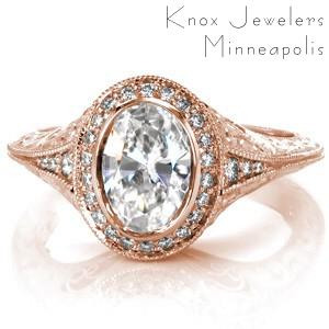 Custom antique inspired engagement ring with an oval cut diamond center surrounded by a diamond halo and a knife edge engraved band in Toronto.