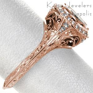 Rose gold engagement ring in Oakland with diamond halo, oval center stone and filigree.