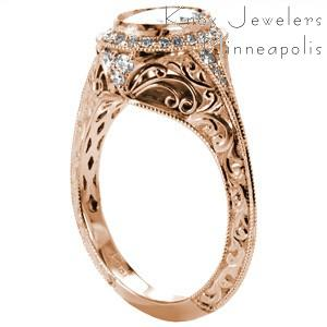 Custom rose gold engagement ring in Detroit with a unique knife edge band and a diamond halo surrounding an oval center diamond.