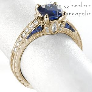 Vintage inspired engagement ring with hand engraving and sapphires in Tampa.