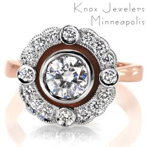 Custom vintage inspired engagement ring in Colorado Springs with a round diamond surrounded by a unique diamond halo made in two tone.