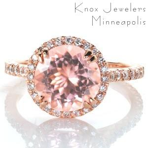 Design 3345 is set with an ethereal 2.20 carat round cut morganite center gemstone and crafted in 14k rose gold. Intricate V-Cut prongs are individually formed by hand, and set with round cut diamonds around the halo and sides of the band. The halo is raised slightly to accommodate a matching wedding band.