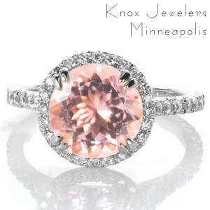 Unique engagement ring in Jacksonville with morganite center stone, diamond halo and micro pave band.