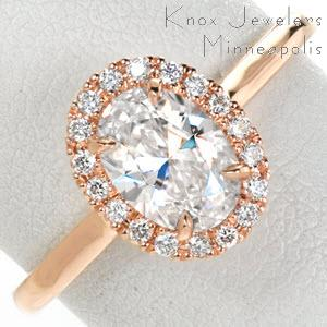 Houston rose gold wedding ring with diamond halo, high polished band and oval center stone.