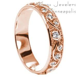 Custom rose gold wedding ring in Louisville with a scroll pattern highlighted by bezel set diamonds.