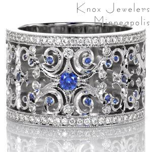 Portland unique sapphire wedding band. This wide band features and intricate filigree pattern set with blue sapphires and diamonds. The antique wedding band style is truly breathtaking!