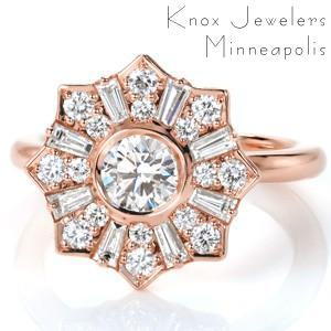 Rose gold halo engagement ring in Chicago. This unique, antique inspired halo features alternated round and baguette cut diamonds surrounding a bezel set center stone. The star-burst of the halo is sure to turn heads!