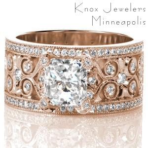 Rose gold custom engagement ring in Oklahoma City with a unique wide diamond patterned band holding an emerald cut diamond center stone.