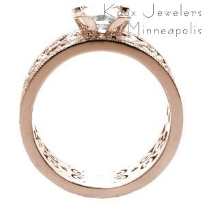 Rose gold custom engagement ring in Charleston with a unique wide diamond patterned band holding an emerald cut diamond center stone.