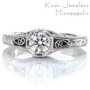 Antique inspired custom engagement ring with a round brilliant diamond held in a unique octagon setting surrounded by milgrain and filigree in Columbus.