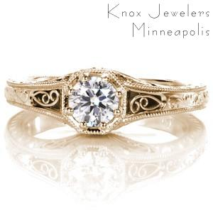 Antique inspired custom engagement ring with a round brilliant diamond held in a unique octagon setting surrounded by milgrain and filigree in Akron.
