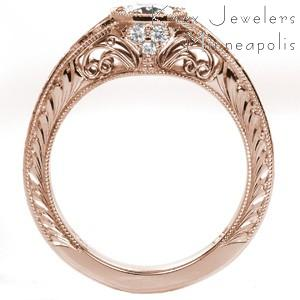 Rose gold custom engagement ring in Des Moines with a round diamond held in a unique octagon setting with hand formed filigree and engraving.
