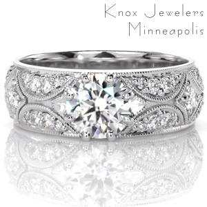Stunning wide engagement ring in Indianapolis. This beautiful unique design is inspired by the stars, and features a round brilliant cut diamond as the focal point of a star burst pattern.