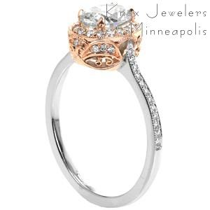 Unique rose gold engagement ring in Providence with a two-tone band. This oval halo rose gold engagement ring features a platinum band with a rose gold micro pave halo and basket. The rose gold antique engagement ring filigree details are stunning!