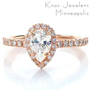 Antique pear engagement rings in Honolulu with a hand-set diamond band and halo.