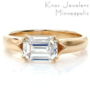 Custom solitaire engagement ring in New Haven with a twisted asymmetrical band holding a round brilliant center stone.